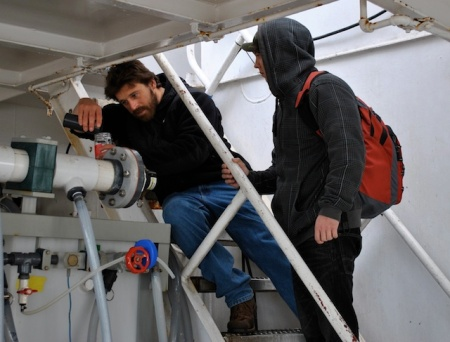 Biological oceanography student Brian Maurer concentrates a water sample to test for zooplankton viability.