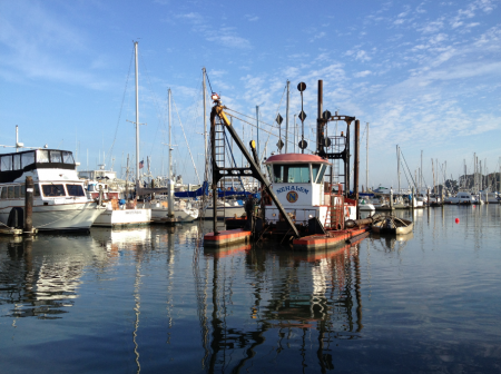 Dredgers in the Moss Landing harbor. Photo by Angela Szesciorka.