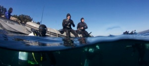 The subtidal ecology class gears up to go on an identification dive.  The water temperature is 11 Celsius (52 F), so thick neoprene suits are used as thermal insulation.